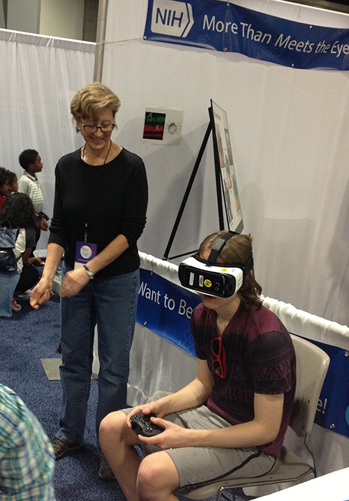 A participant wears special googles and experiences how the brain compensates for vision loss. (NEI)